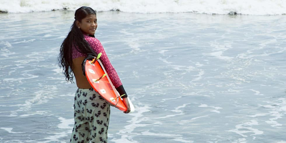 Nasima Aker surfing
